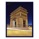 Arco do Triunfo de l'Étoile no tiro da noite de Pa Impressão De Foto