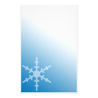 Artigos de papelaria azuis do inclinação do floco
