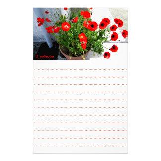 Artigos de papelaria vermelhos da foto da papoila