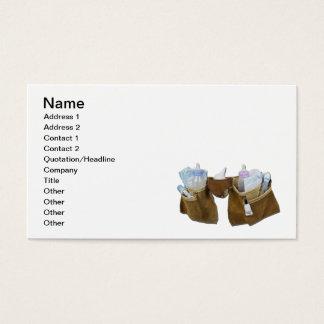 Artigos do bebê que enchem a correia de couro da cartão de visitas