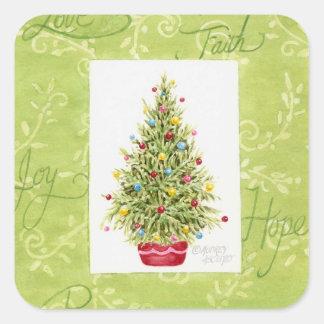Árvore de Chritmas das etiquetas do Natal no pote