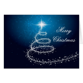 Árvore de Natal no cartão de incandescência azul