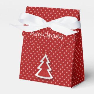 Árvore do Feliz Natal & caixa vermelhas do favor