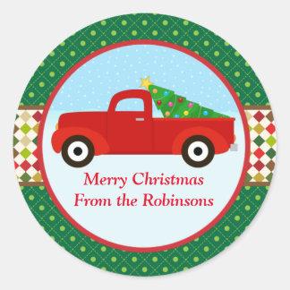 Árvore do Feliz Natal em uma etiqueta do caminhão