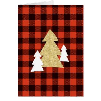 Árvores de Natal no cartão vermelho do feriado da