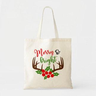 As bolsas alegres & brilhantes do Natal do Antler