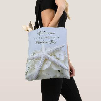 As bolsas da boa vinda do casamento de praia da