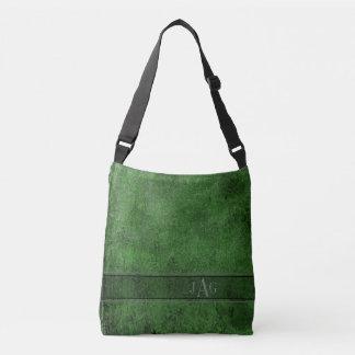 As bolsas rústicas da capa do livro no verde