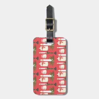 As velas festivas imprimem o vermelho tags de mala