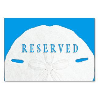 Assento reservado azul tropical do dólar de areia