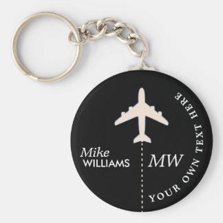 avião branco no chaveiro preto com nome
