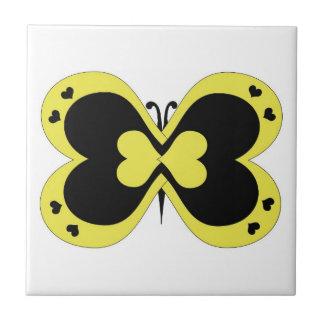 Azulejo amarelo e preto da borboleta