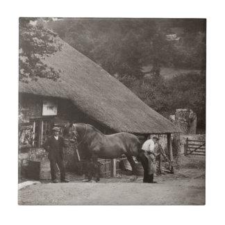 Azulejo da foto do vintage do ferreiro da vila