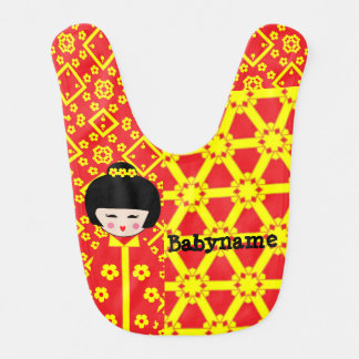 Babador asiático do bebê da boneca do
