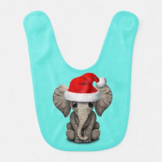 Babador Elefante do bebê que veste um chapéu do papai noel