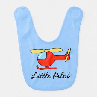Babador piloto pequeno do bebê com helicóptero do