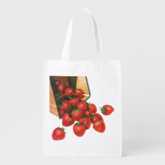 Bagas da fruta da comida do vintage, morangos na sacola ecológica