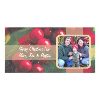 Bagas do azevinho e cartão com fotos da família da cartão com foto