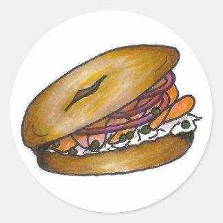 Bagel de New York com etiquetas do queijo creme e Adesivo