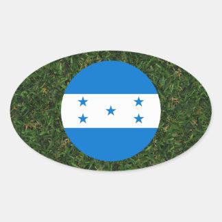Bandeira de Honduras na grama Adesivo Oval