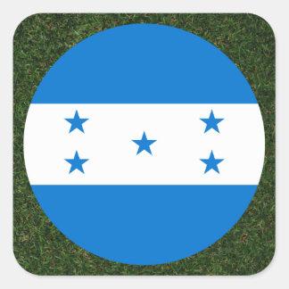 Bandeira de Honduras na grama Adesivo Quadrado