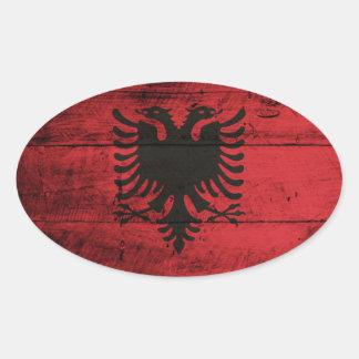 Bandeira de madeira velha de Albânia Adesivo Oval