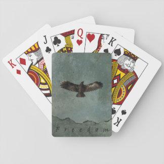 Baralho Um corvo em vôo no fundo verde & cinzento de
