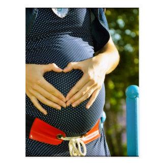 Barriga da mulher gravida cartão postal
