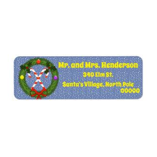 Bastão de doces em etiquetas de endereço do