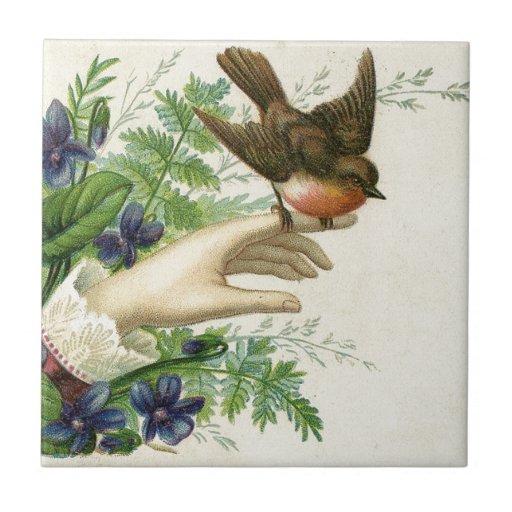 Beautiful hand with a bird and flowers azulejo de cerâmica