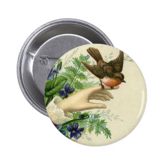 Beautiful hand with a bird and flowers botons