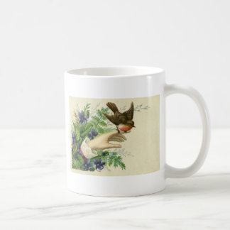 Beautiful hand with a bird and flowers caneca