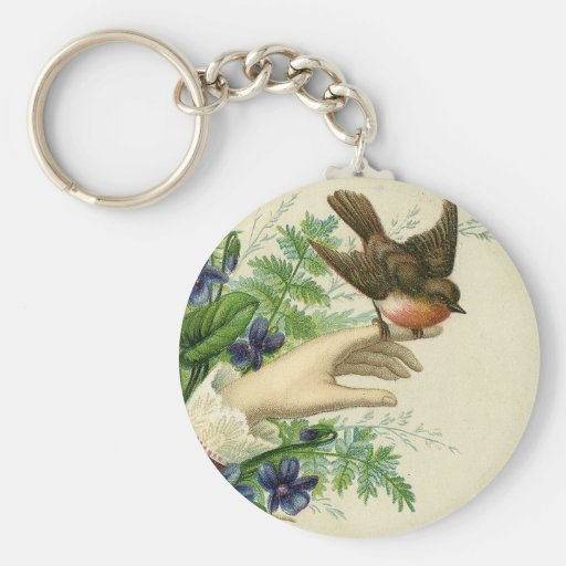 Beautiful hand with a bird and flowers chaveiros