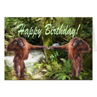 Bebês do orangotango no cartão de aniversário da s