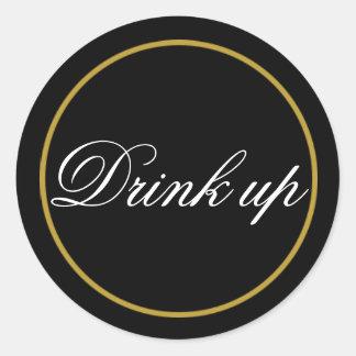 Bebida acima do ouro do preto da etiqueta do