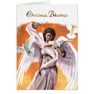 Bênçãos do Natal. Cartões de Natal do anjo do Afro