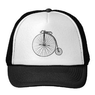 Bicicleta antiga do Farthing da moeda de um centav Boné