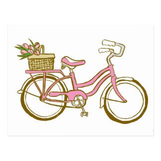 Bicicleta cor-de-rosa bonito com tulipas cartões postais