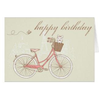 Bicicleta cor-de-rosa com o cartão do feliz aniver