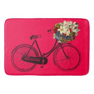 Bicicleta cor-de-rosa da bicicleta da flor do tapete de banheiro