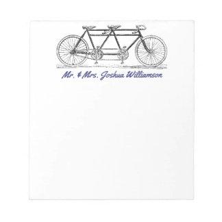 Bicicleta do vintage construída para o monograma bloco de notas
