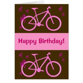 Bicicleta no cartão cor-de-rosa do feliz aniversar