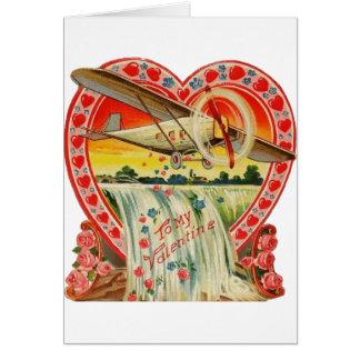 Biplano do vintage sobre o cartão dos namorados da