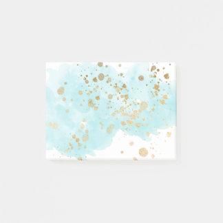 Bloco Post-it O azul etéreo nubla-se o Spatter do ouro