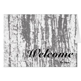Boa vinda ao borrão de madeira do fundo do rosa da cartão comemorativo