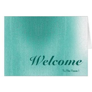 Boa vinda ao borrão do verde do fundo do rosa da cartão comemorativo