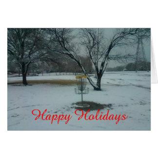 Boas festas a cesta no cartão da neve