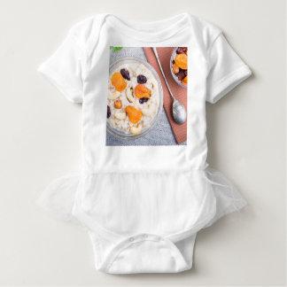 Body Para Bebê Ideia superior de uma parcela de farinha de aveia