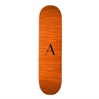Bois alaranjados do falso do monograma skate