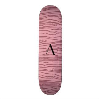 Bois cor-de-rosa bonito do falso do monograma skate